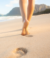 relaxing footprints in the sand shutterstock
